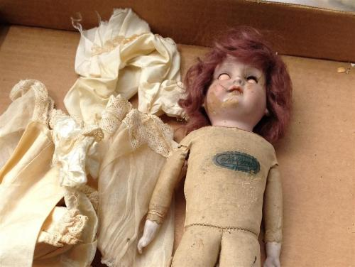 partially-rotted-doll