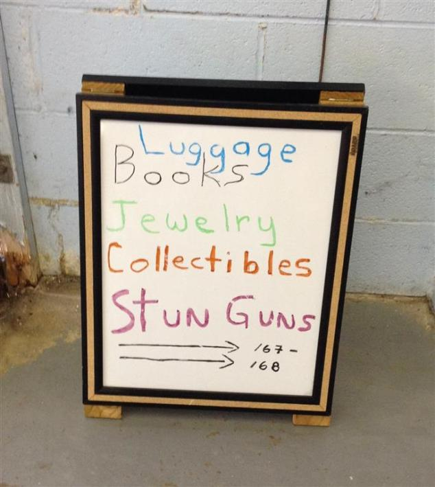 luggage-books-stun-guns