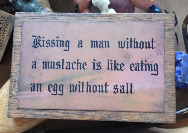mustache-kissing-sign